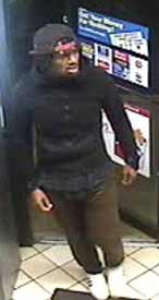 Surveillance photo of suspect in Royal Farm robbery on November 26, 2013.