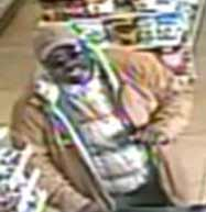 Surveillance photo of male suspect in multiple theft cases.