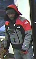 Photo of a man who may have details in the case as he was inside the store during the shooting.