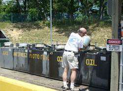 Photo of person disposing of household hazardous waste.