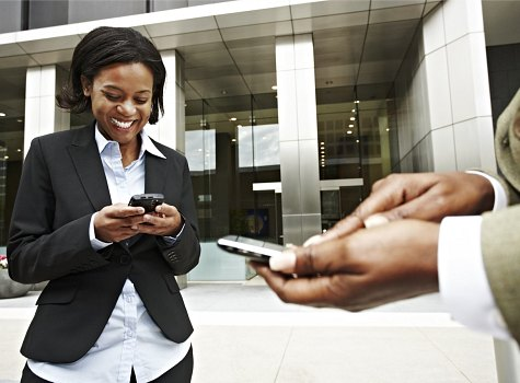 photo of young businesswoman on smartphone