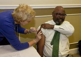 photo of man getting flu shot