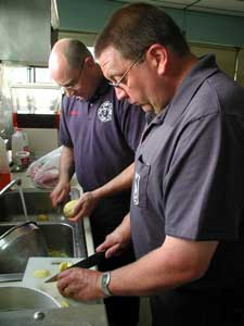 Image of station crews preparing food.