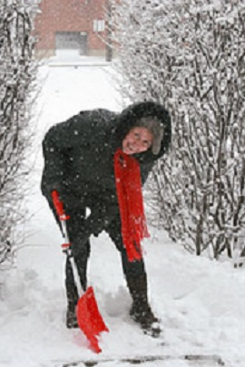 photo of woman shovelling snow