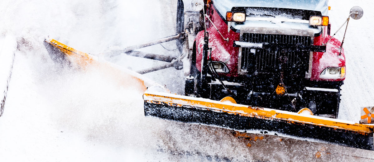 A snowplow pushing snow.