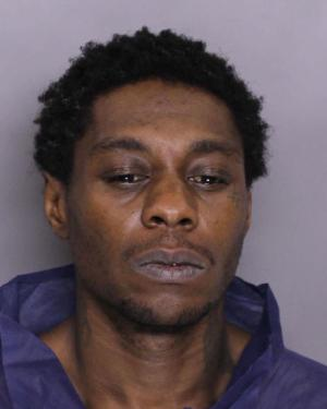 Booking photo of Dwayne Kenneth Taylor, homicide suspect