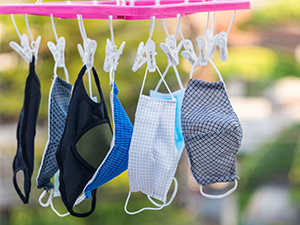 Photo of face masks hanging